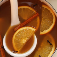 This healthy Mulled Apple Cider is a cozy winter hot drink made with fresh apple juice, orange, cinnamon, cloves and ginger