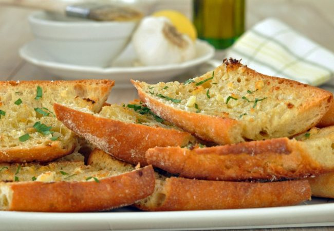 This Italian Garlic Bread is an easy homemade garlic bread recipe made with a little butter, olive oil, garlic, parmesan cheese, lemon zest and parsley