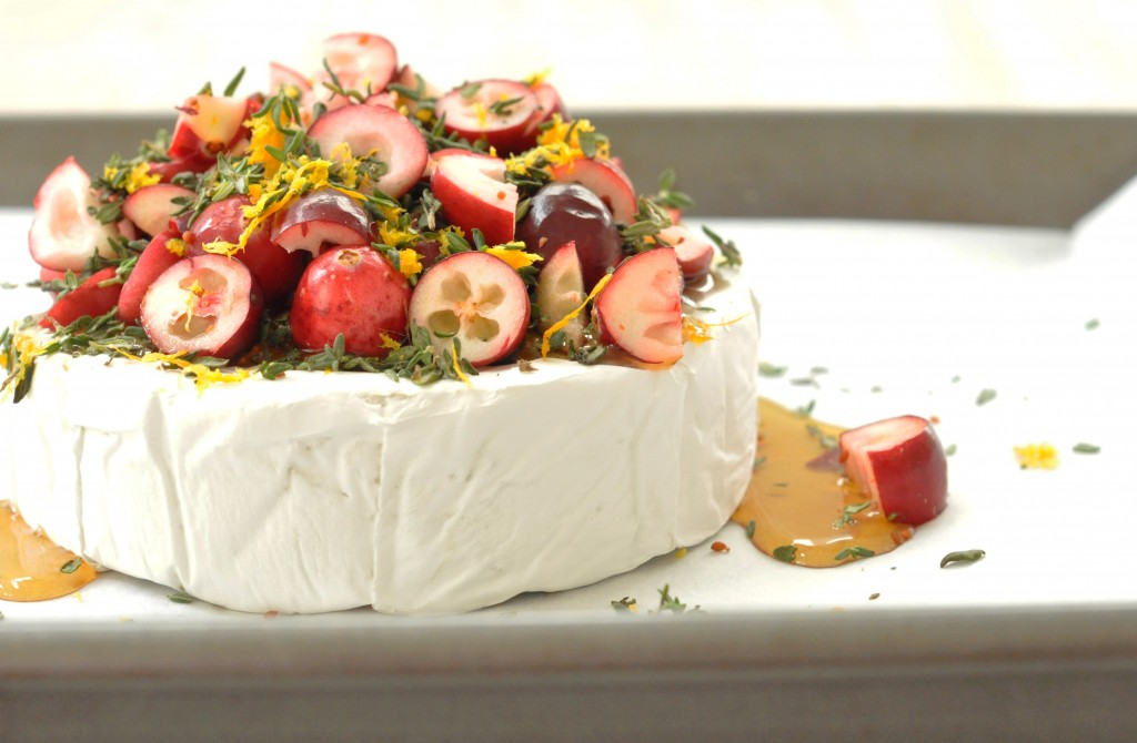This Cranberry Baked Brie is made with brie, fresh cranberries, thyme, orange zest and pure maple syrup