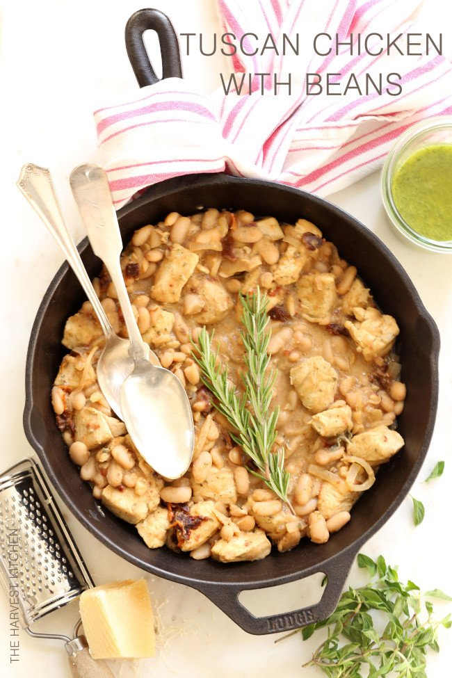 This healthy Tuscan Chicken with White Beans is an easy skillet chicken dinner recipe that comes together in about 20 minutes
