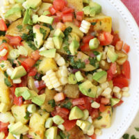 This Mexican Potato Salad is loaded with corn, tomatoes, avocado, green onion and cilantro all tossed in a cilantro lime vinaigrette