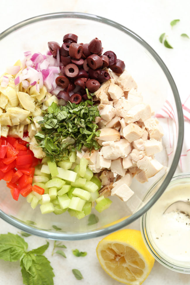 This Healthy Italian Chicken Salad is loadedwith tender bites of chicken breast, red bell pepper, red onion, artichoke hearts, kalamata olives, celery and fresh herbs