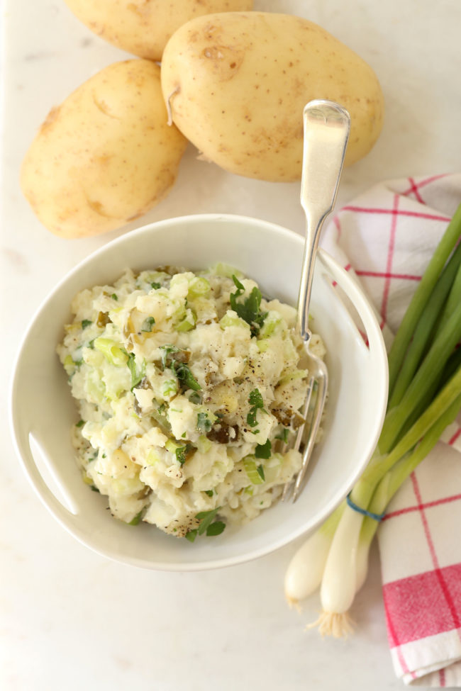This creamy Dill Pickle Potato Salad is made with potatoes, celery, green onion, parsley and dill pickles all tossed in a light dressing