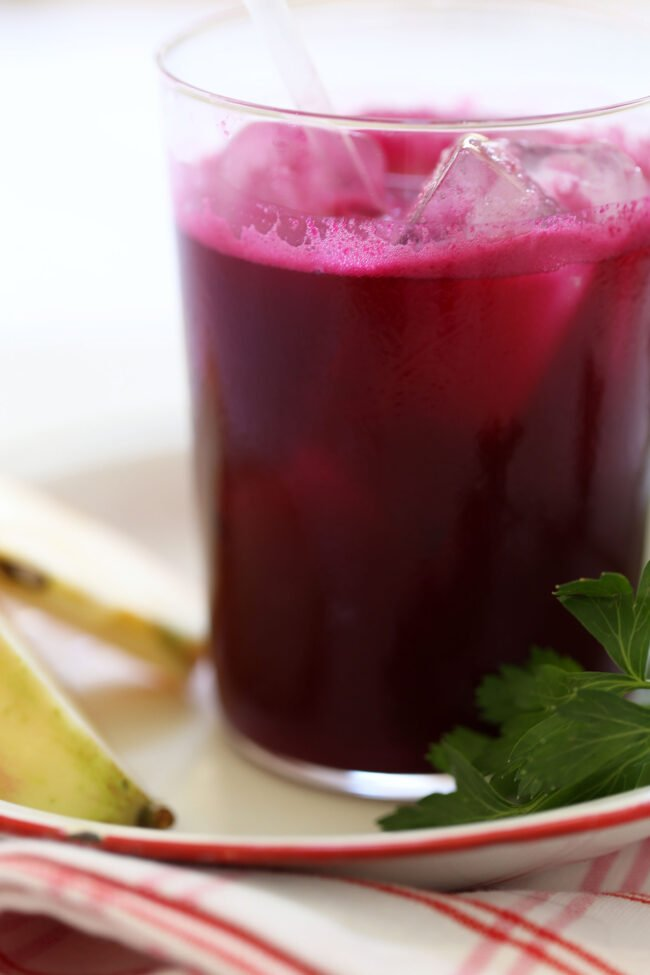 This Beet Ginger Detox Drink is made with beets, apples, a whole lemon, fistful of parsley and ginger