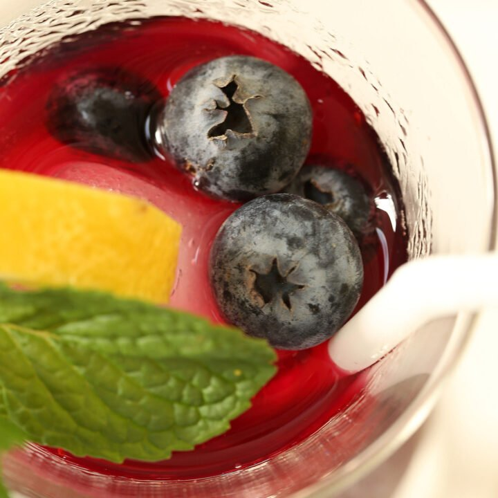 glass of immunity booster drink made of blueberries and green tea