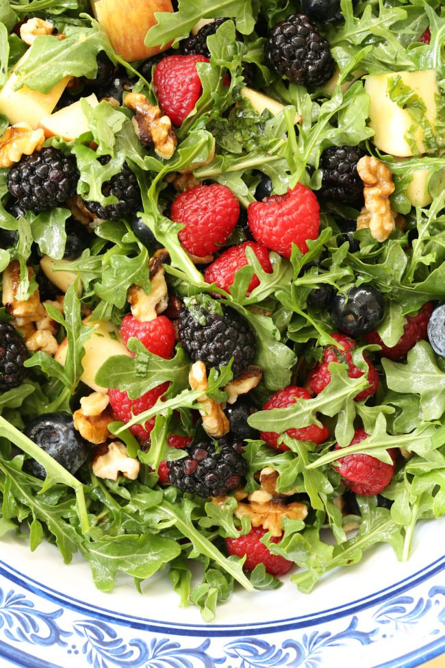This Immune Boosting Arugula Berry Salad combines wild arugula with a mix of fresh sweet berries, apple and walnuts all tossed in a citrus vinaigrette