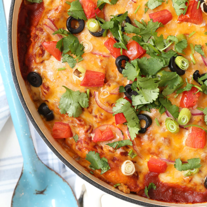 This Easy Turkey Enchilada Casserole is loaded with ground turkey, corn, pinto beans, tortillas and an easy homemade enchilada sauce