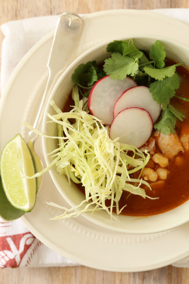 Mexican Chicken Posole (also referred to as chicken pozole) is a  richly flavored soup made with chicken, hominy, garlic and onion all simmered in a broth with authentic Mexican flavors.