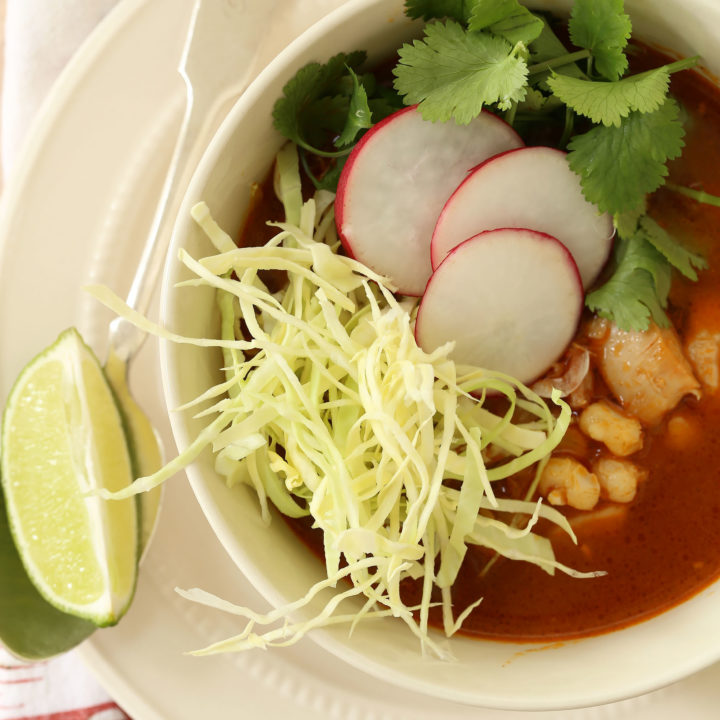 Mexican Chicken Posole (also referred to as chicken pozole) is a  richly flavored soup made with chicken, hominy, garlic and onion all simmered in a broth with authentic Mexican flavors