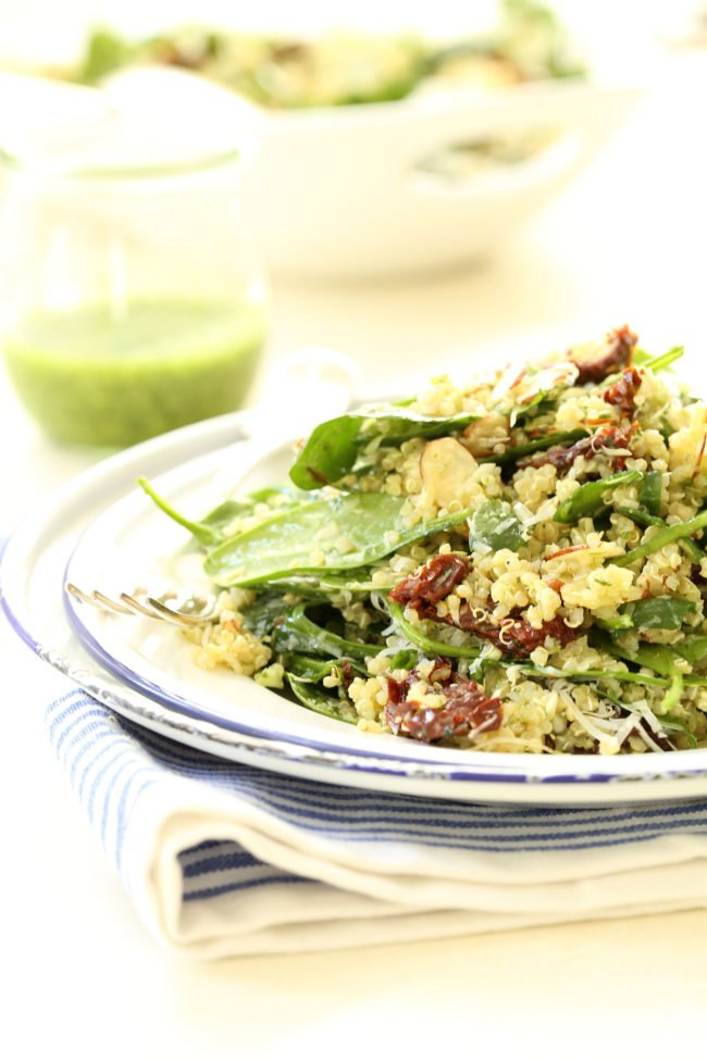 This Spinach Quinoa Salad is loaded with quinoa, baby spinach, sun-dried tomatoes, sliced almonds all tossed in a light basil pesto dressing