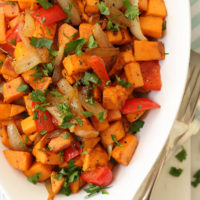 These Breakfast Sweet Potatoes are studded with red bell pepper, garlic and onions