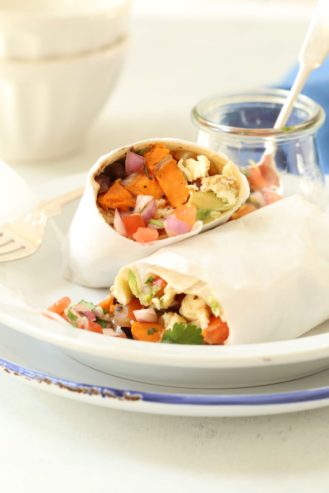 These Healthy Breakfast Burritos are stuffed with scrambled eggs, black beans, sweet potatoes, avocado and pico de gallo