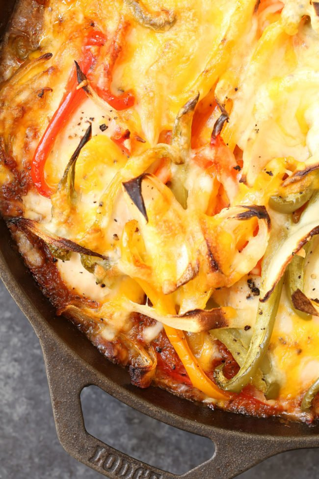 Easy Chicken Fajita Bake is a healthy Mexican chicken dish that's moist and tender and smothered with tomatoes, onions and peppers