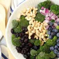 Broccoli Detox Salad is crisp and crunchy and loaded with broccoli, blueberries, cranberries and onion all tossed in a delicious light orange dressing