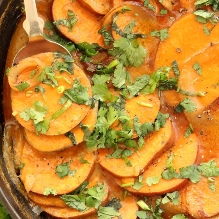 These Coconut Curry Scalloped Sweet Potatoes are made with layers of sweet potatoes, sautéed onion and garlic simmered in a delicious coconut curry sauce