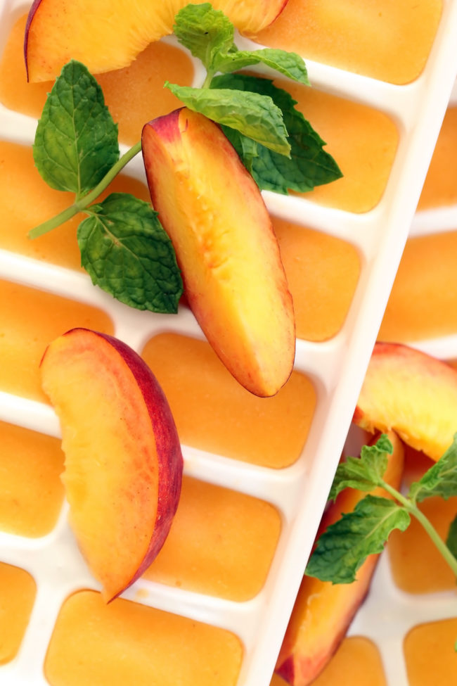 These Summer Peach Ice Cubes are made with peach puree and will transform a tall glass of water or your favorite iced tea into a delicious summer drink
