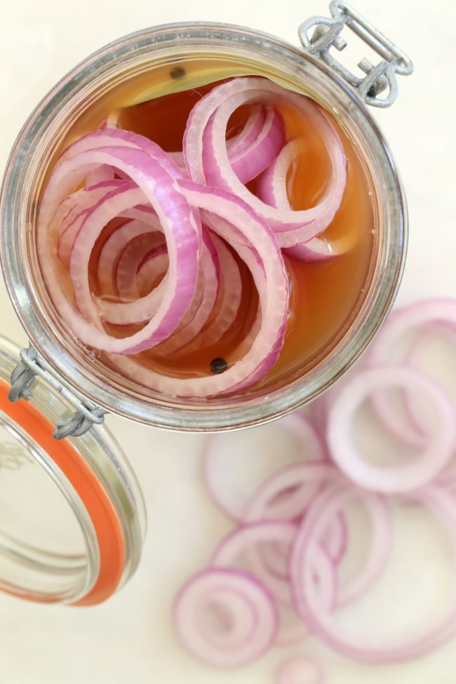 These Quick Pickled Onions (also referred to as Pickled Red Onions) instantly upgrade any dish they're added to, like salads, tacos and burgers