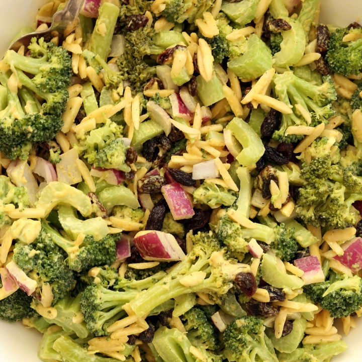 Easy broccoli salad is one of those super salads made with broccoli, celery, onion, raisins and almonds tossed in a curry dressing
