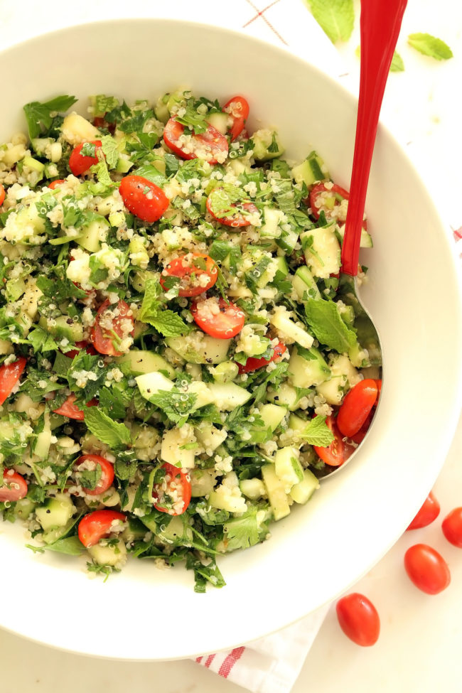 This Crunchy Quinoa Tabbouleh Salad features fresh parsley, mint, green onion, cherry tomatoes, cucumber, and a bit of apple