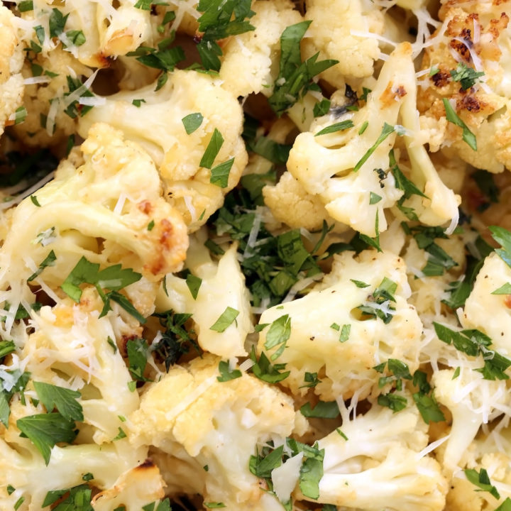 This Garlic Parmesan Roasted Cauliflower is tossed in parmesan cheese and makes an easy healthy side dish to serve any night of the week