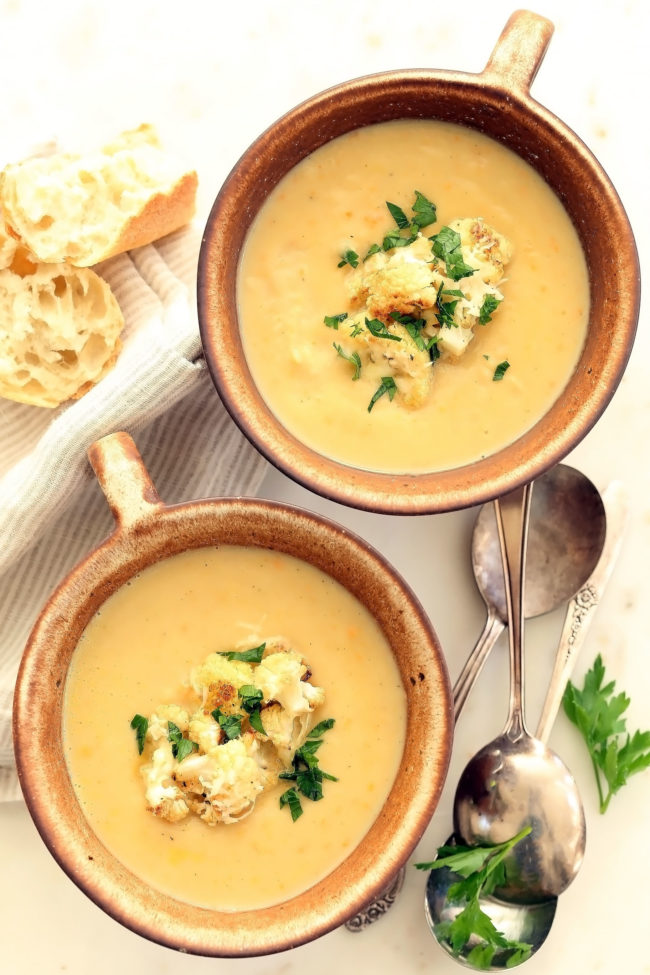 This Creamy Cauliflower White Bean Soup is loaded with cauliflower, carrots, celery, onion and white beans