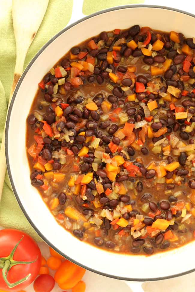 This Vegetarian Black Bean Stew makes a perfect comforting meal any night of the week.  The recipe calls for canned black beans, so this simple dish comes together in a pinch