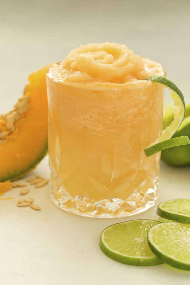 This Cantaloupe Lime Slush is made with frozen cantaloupe chunks, fresh lime, and coconut water and makes a delicious healthy snack or dessert