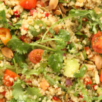 This Mexican Quinoa Salad is a powerhouse salad packed with quinoa, cucumber, arugula, red pepper, pico de gallo, toasted nuts and lots of fresh cilantro