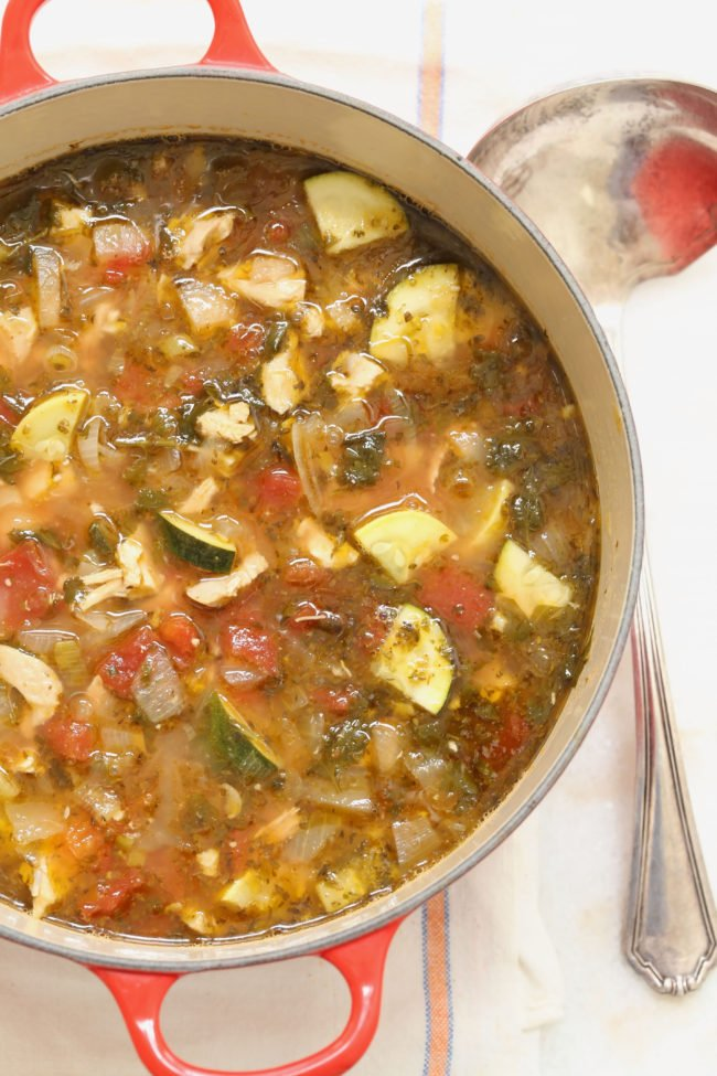 This healthy chicken tortilla soup is cluttered with chopped chicken and fresh vegetables, and it's seasoned with delicious authentic Mexican flavors (cumin, oregano and fresh cilantro) that will have you hooked at first bite