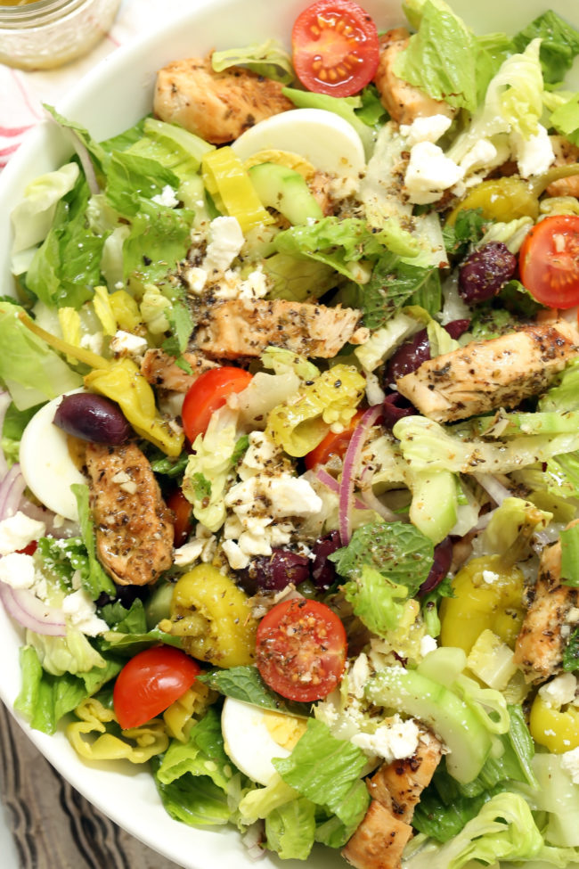 This Greek Chopped Salad is loaded a variety of fresh organic vegetables, marinated grilled chicken, hardboiled eggs and it's all tossed in a delicious Greek salad dressing