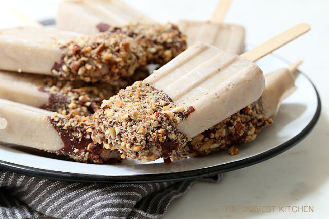 These Almond Milk Popsicle are made with almond milk, almond butter, bananas and Greek yogurt, then dipped in chocolate sauce and rolled in toasted almonds