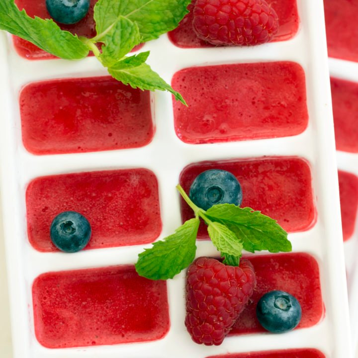 These Summer Berry Ice Cubes are made with fruit puree and add a refreshing pop of flavor and extra antioxidant benefits to a glass of water or tea