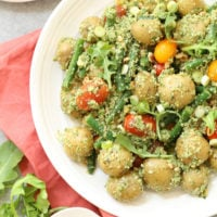 This Arugula Pesto Potato Salad is likely to be one of the easiest potato salads you'll ever make.    Tender baby potatoes are mixed with green beans and heirloom cherry tomatoes, then it's all tossed in a delicious nutty arugula pesto
