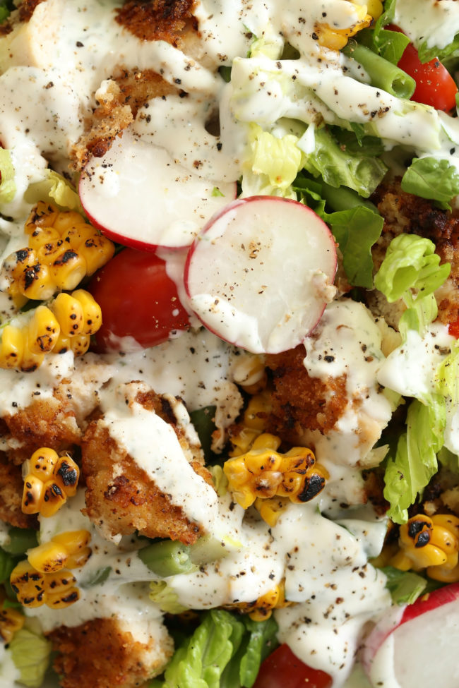 Fried Chicken Chopped Salad is loaded with fried chicken, grilled corn, green beans, radishes and cherry tomatoes all tossed in a buttermilk ranch dressing