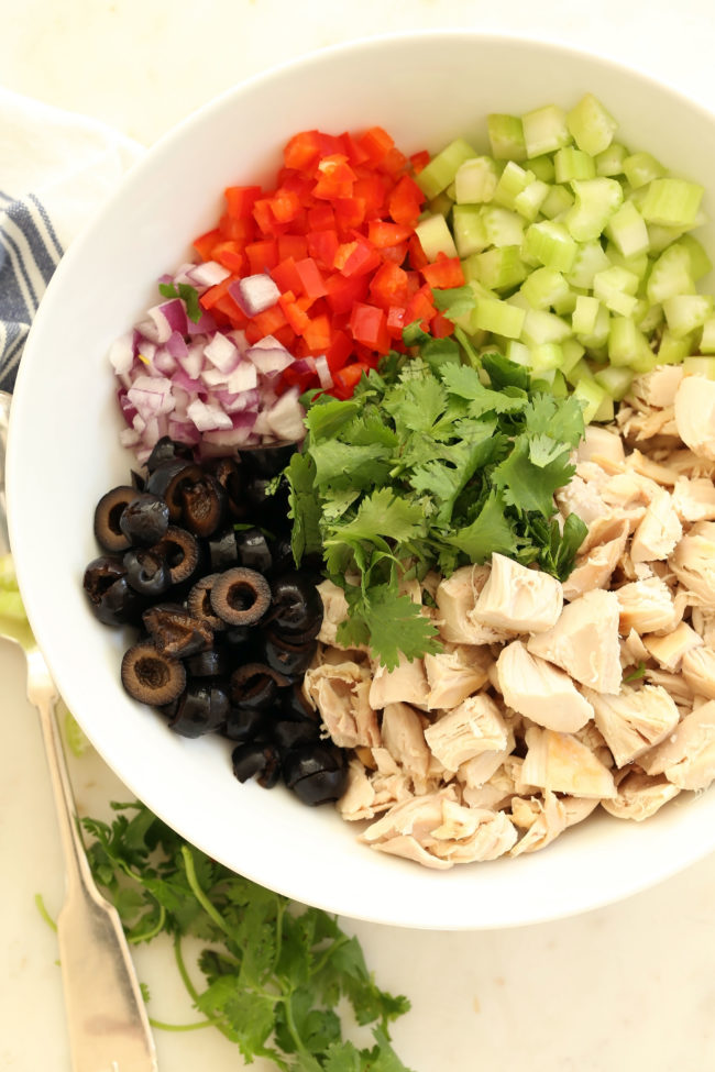 Avocado Chicken Salad is an easy chicken and avocado salad made with chicken, vegetables and black olives all tossed in a vegan avocado mayo