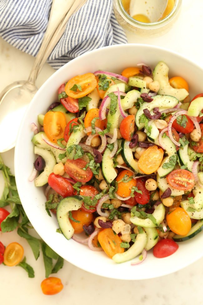This Mediterranean Chickpea and Cucumber Salad is a fresh summery salad that's made with cucumbers, ripe juicy tomatoes, chickpeas, purple onion and fresh mint leaves