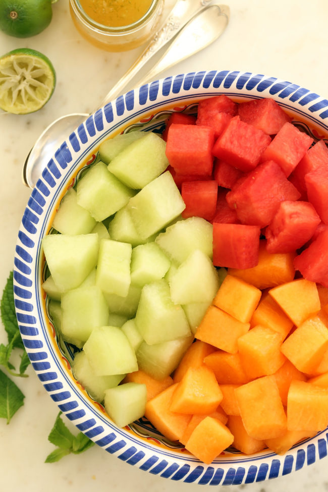 Summer Melon Salad with Honey Lime Dressing is a mix of watermelon, cantaloupe and honeydew