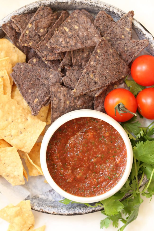 This Restaurant Style Salsa is bursting with a delicious combo of flavors, has a wee bit of heat,  and comes together in  about 5 minutes