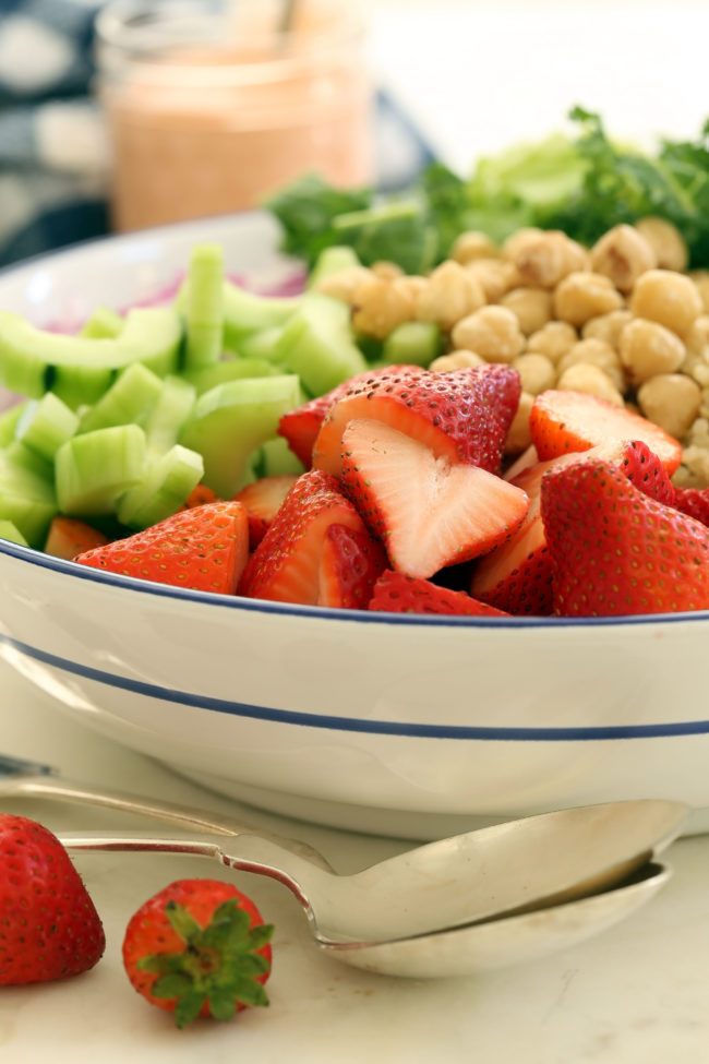 This Strawberry Kale Salad is fresh, light and nutritious and it's tossed in a delicious whole strawberry vinaigrette