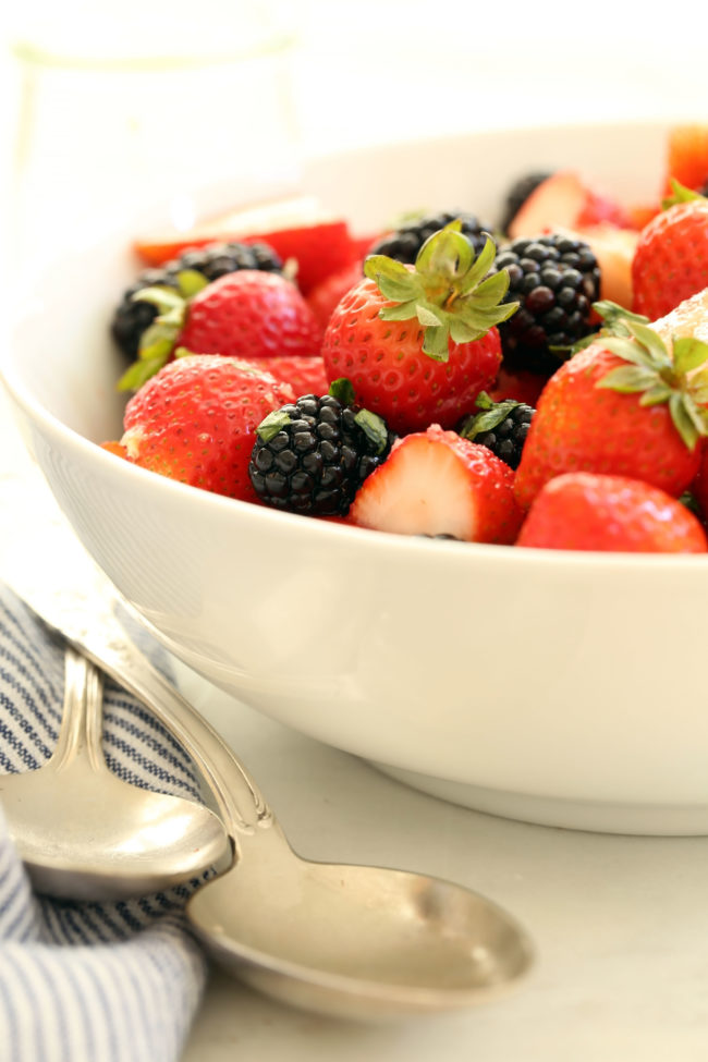This delicious Summer Berry Salad with Honey Lemon Dressing and basil is an easy fruit salad to pull together