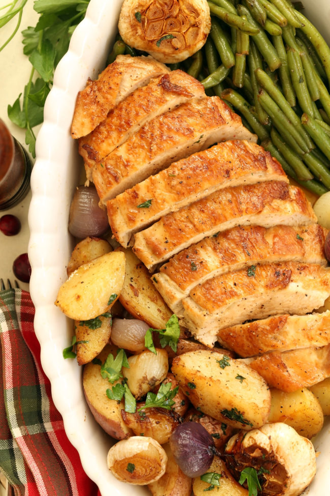 pan of roast turkey breast with vegetables