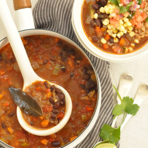 This Black Bean Soup is loaded with onion, garlic, carrots, celery, red pepper and tomatoes in a richly flavored broth