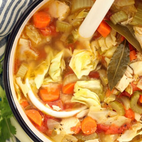 This Mexican Chicken Soup with Cilantro Jalapeno Pesto is crowded with carrots, celery and green cabbage and seasoned with classic Mexican flavors