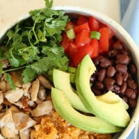 These Taco Bowls with Spanish Quinoa are made with grilled chicken, black beans, Spanish quinoa, lettuce, tomatoes, onion and cilantro