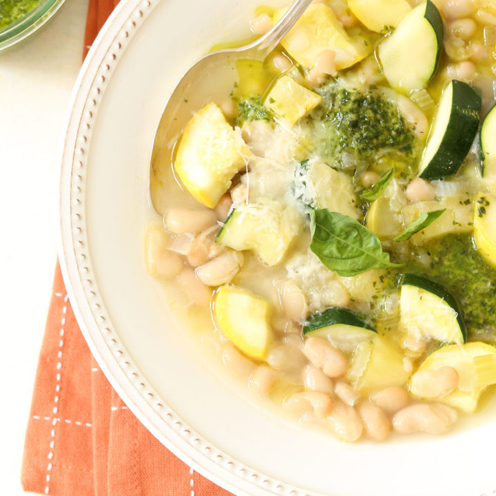 This nourishing Summer Squash Soup is chockfull of chunky pieces of zucchini and yellow squash, onion, celery and cannellini beans, all simmered in a delicious broth
