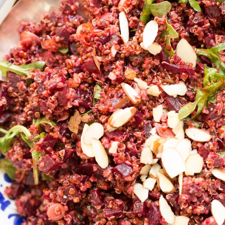 Quinoa Beet Salad is a delicious cold quinoa salad with a mix of red quinoa, chopped beets, arugula, green onion, raisins and sliced almonds