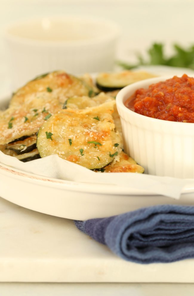 These Baked Parmesan Zucchini Rounds are made with zucchini, parmesan cheese and fresh herbs