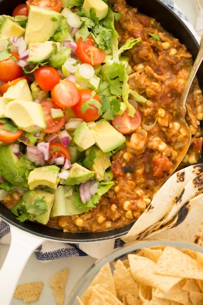 This Taco Skillet is made with ground turkey, beans, corn and salsa and makes the best turkey tacos, turkey taco bowls and turkey taco dip