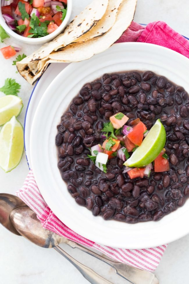 Learn how to cook black beans from scratch with dried beans, onion, garlic and bay leaves