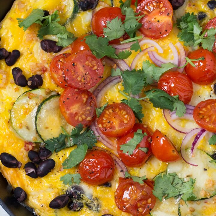 This Spanish Frittata is loaded with zucchini, onion, garlic, black beans, quinoa, a little cheese and of course eggs. This is an easy breakfast frittata that you whole family will love!
